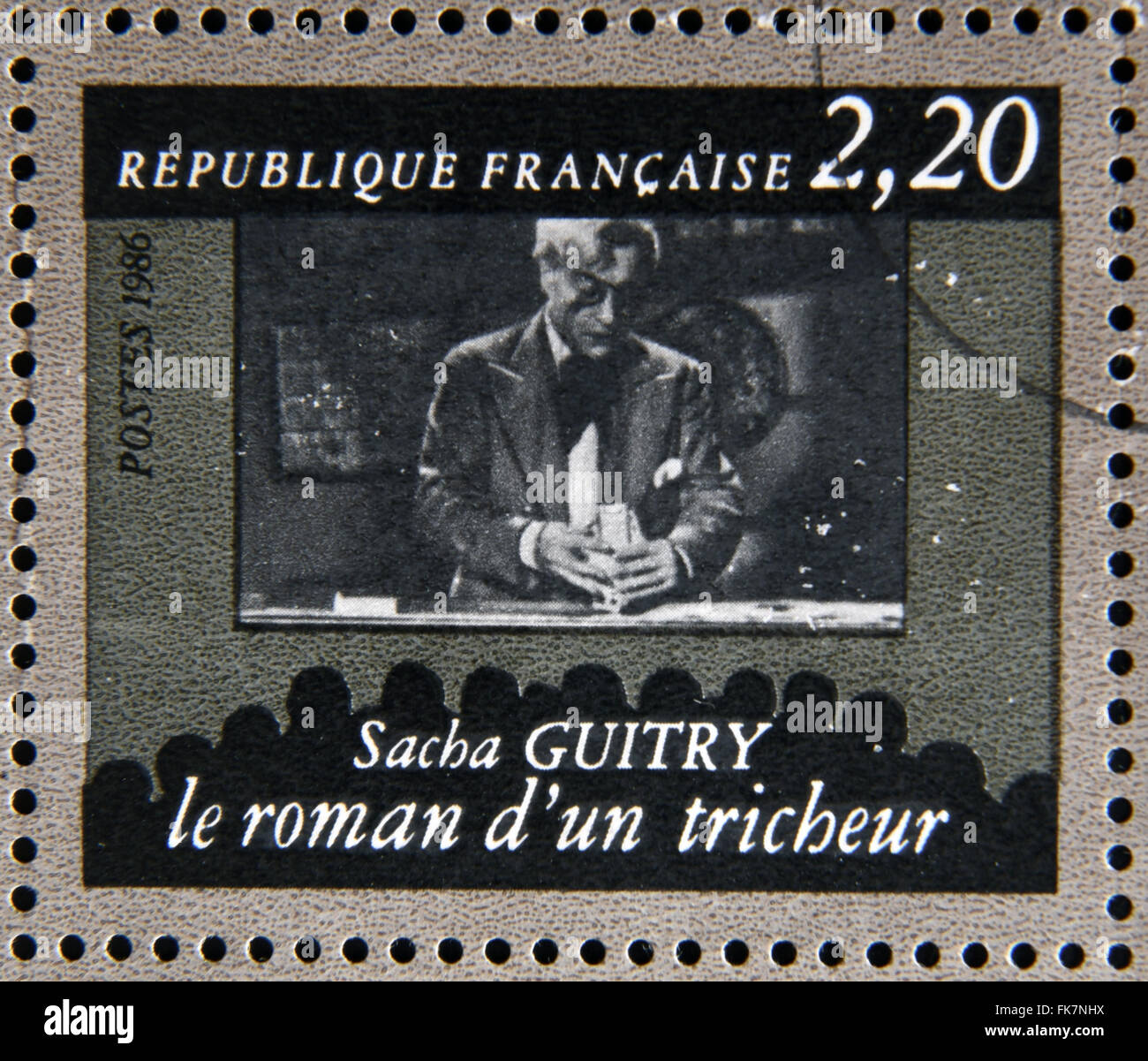 FRANCE - CIRCA 1986: stamp dedicated to centenary of the French cinema shows Sacha Guitry 'The romance of a - Stock Image