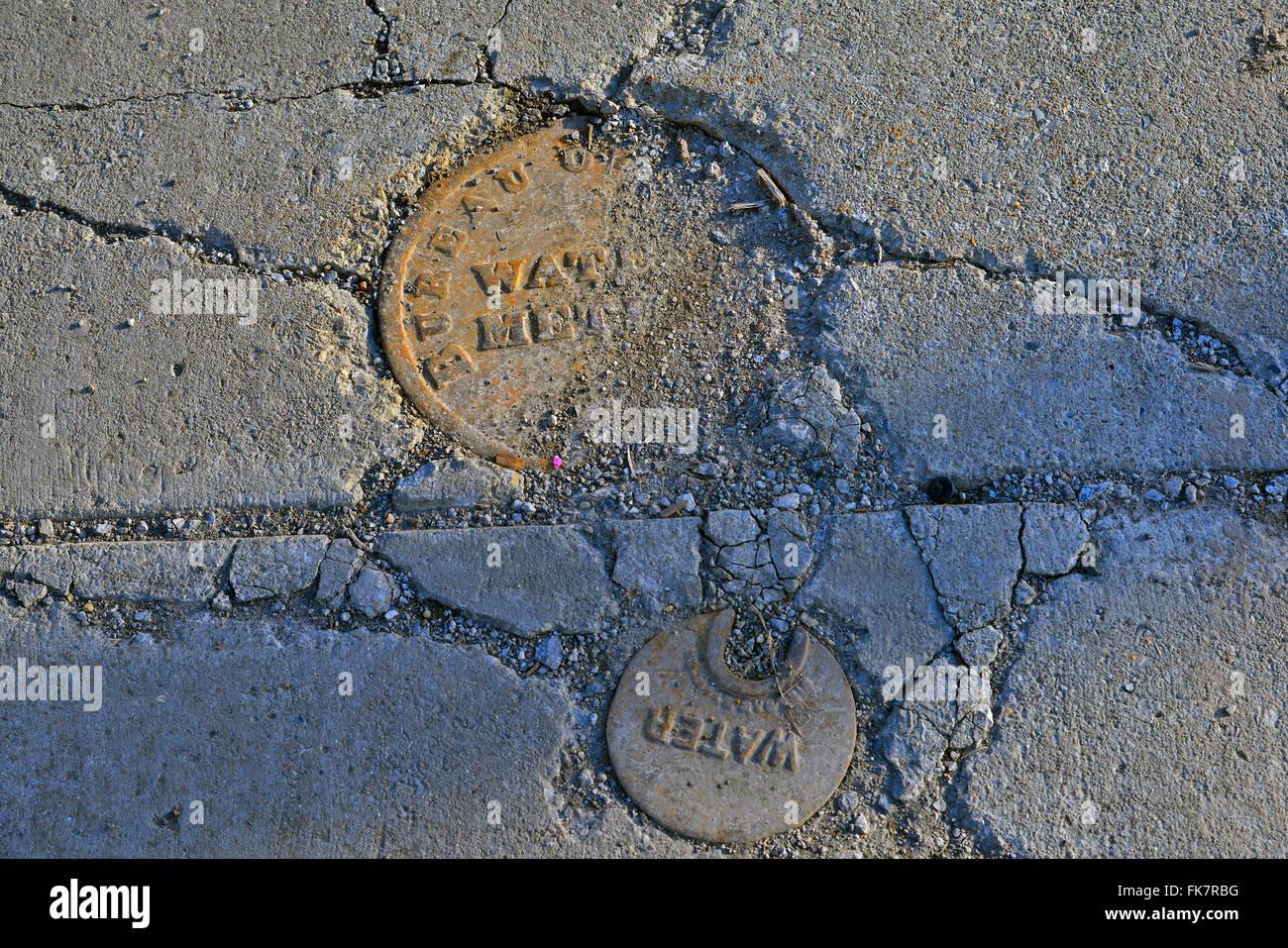 Water meter access in sidewalk - Stock Image