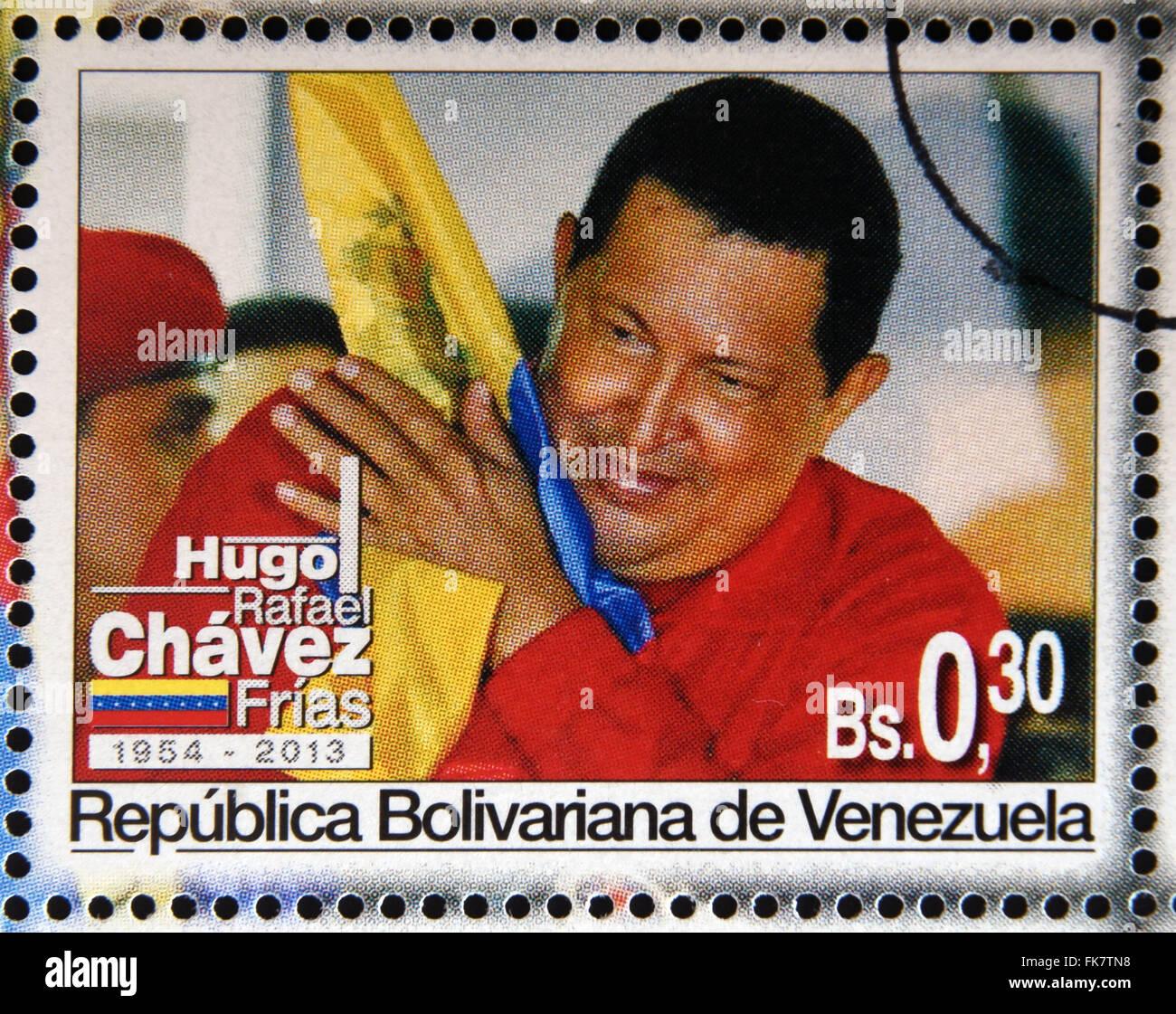 BOLIVARIAN REPUBLIC OF VENEZUELA - CIRCA 2013: A stamp printed in Venezuela shows Hugo Rafael Chavez (1954-2013), - Stock Image