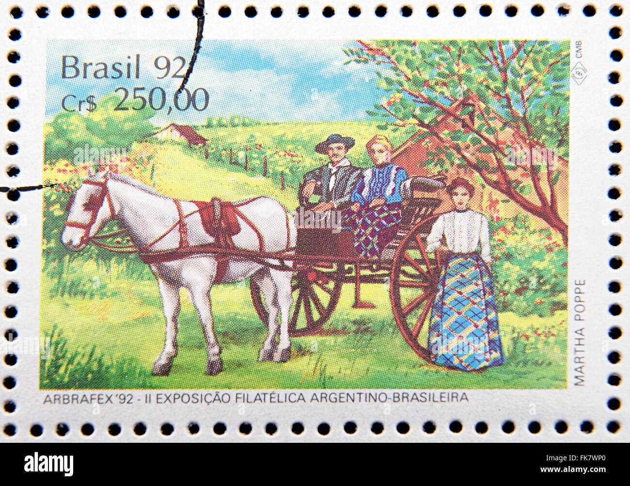 stamp printed in Brazil dedicated to costume gauchos, shows Couple in horse-drawn cart and woman Stock Photo