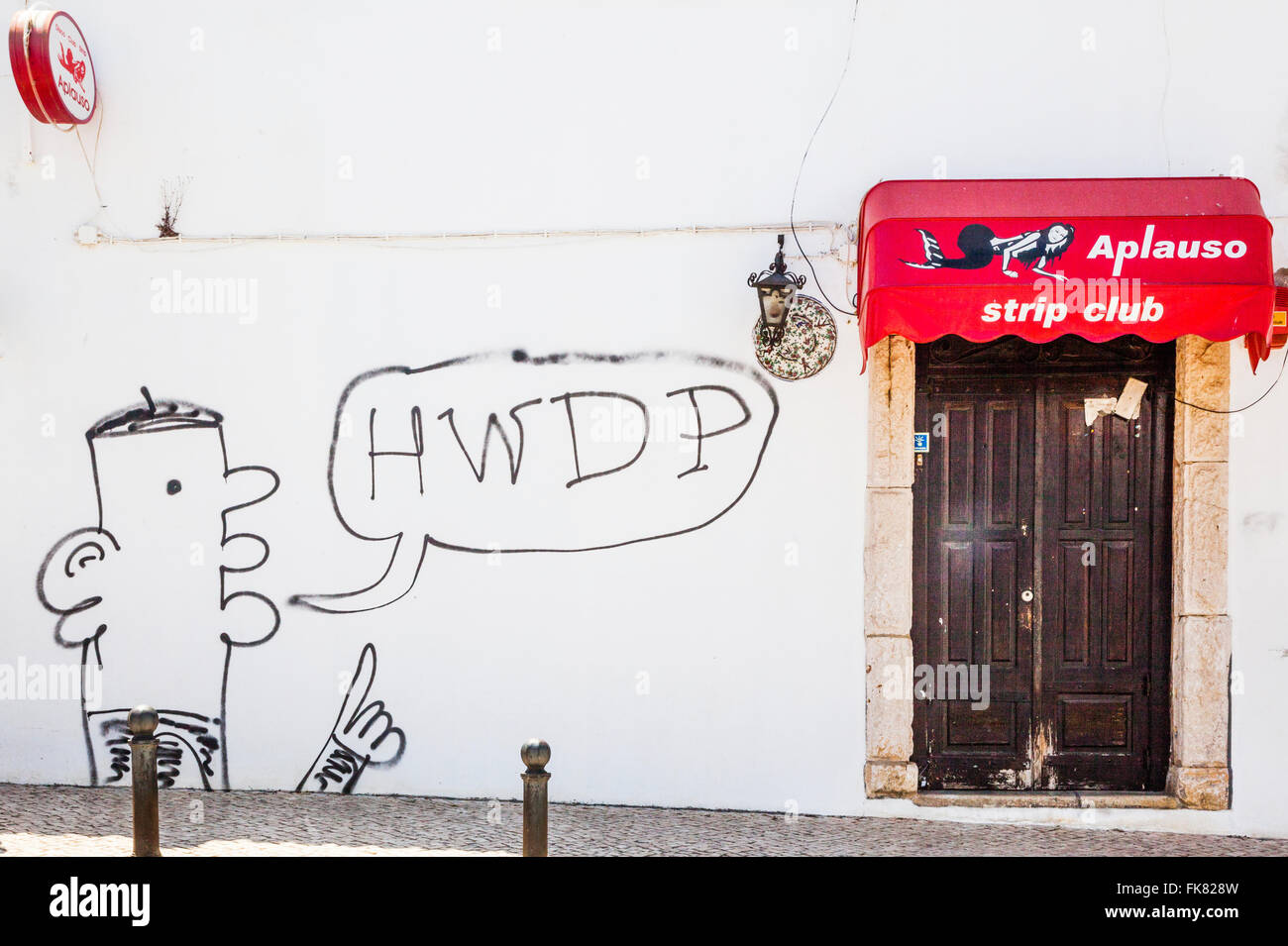 Portugal, Algarve, strip club entrance with graffiti in the historic centre of Lagos, - Stock Image