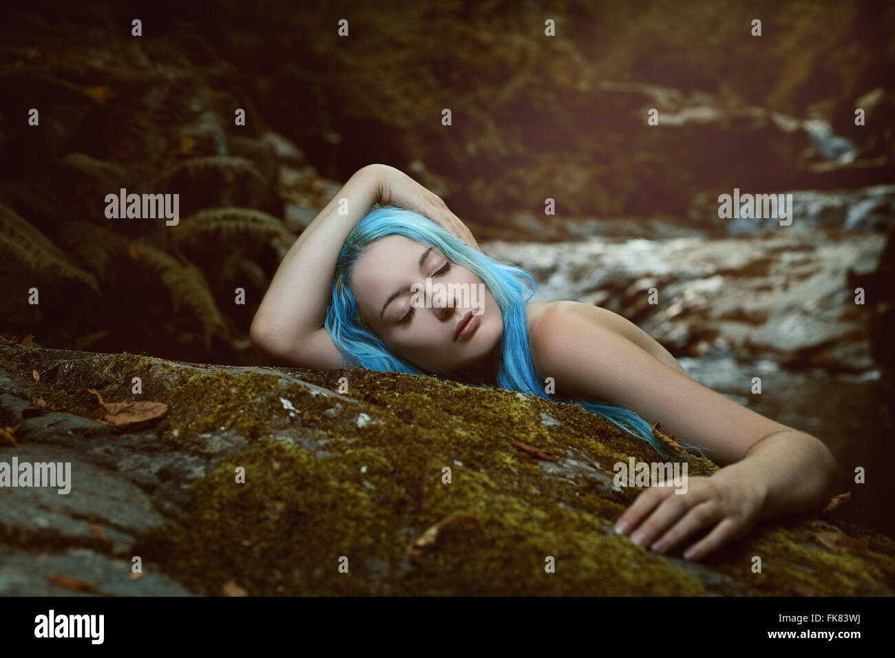 Forest dryad sleeping peacefully in the wood. Romance and fantasy - Stock Image