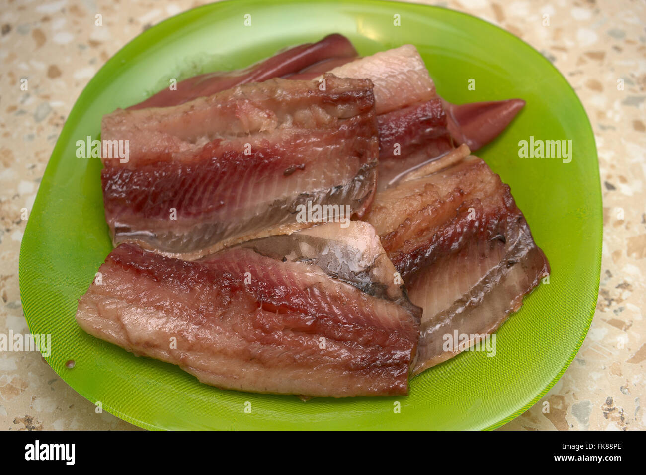 Purified herring on a plate. - Stock Image