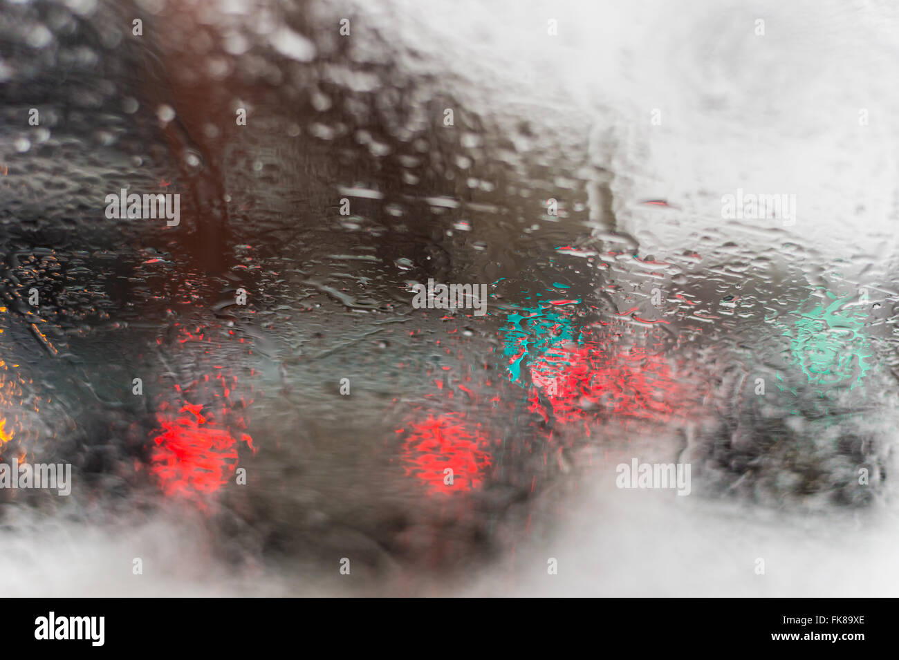 Road view through car window with rain drops and melting snow, Driving during snow storm in Montreal - Stock Image