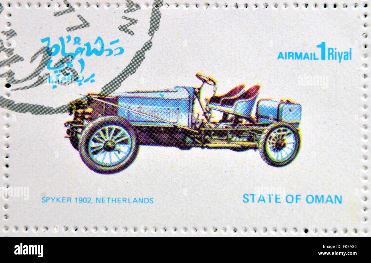 OMAN - CIRCA 1977: A stamp printed in State of Oman shows a old car, Spyker 1902 Netherlands, circa 1977 - Stock Image