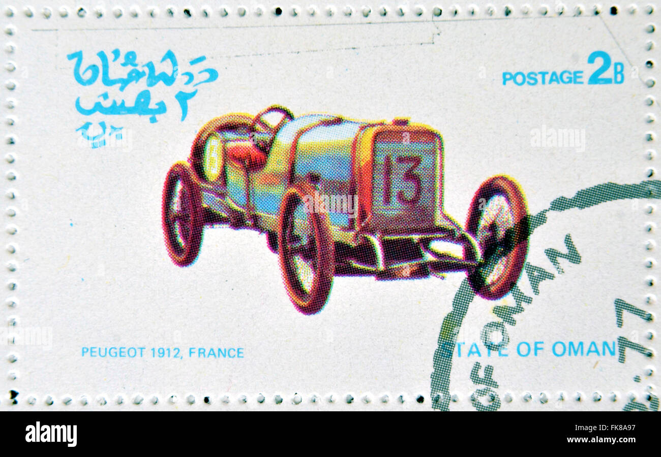OMAN - CIRCA 1977: A stamp printed in State of Oman shows a old car, Peugeot 1912, France, circa 1977 - Stock Image