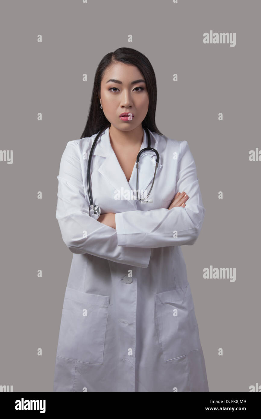 Asian doctor in medical gown with a stethoscope around his neck, the ...