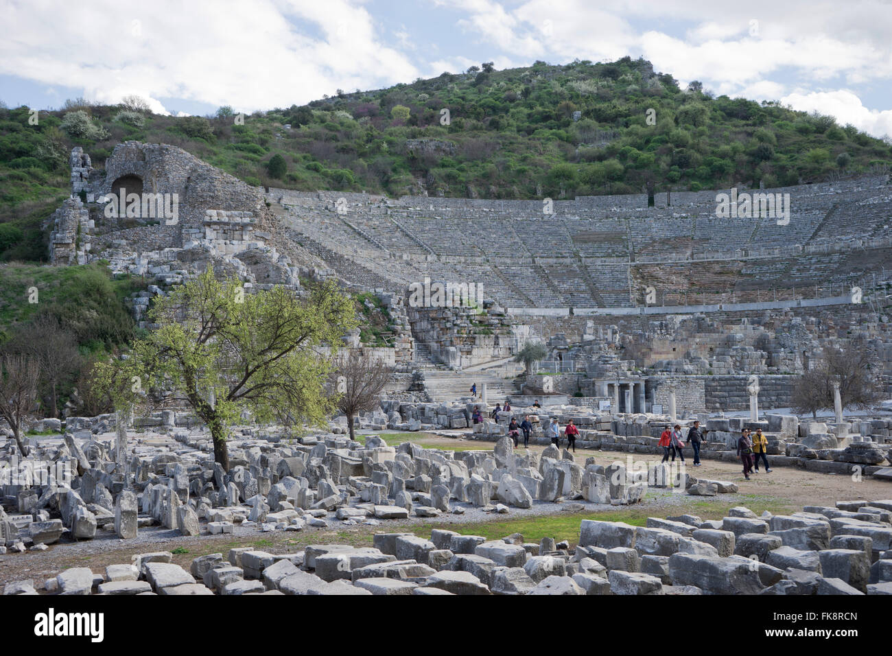 Tourists visit the ancient Greek and Roman periods city of Ephesus in Turkey - Stock Image