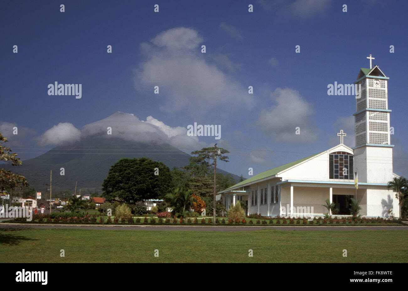 Church in La Fortuna with Volcan Arenal in distance, Guanacaste, Costa Rica - Stock Image