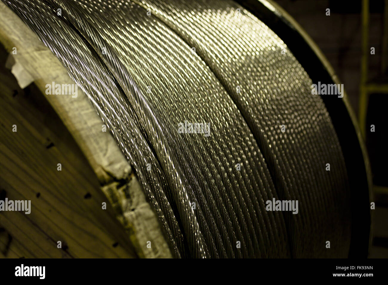 Detail of aluminum cable reel - Stock Image