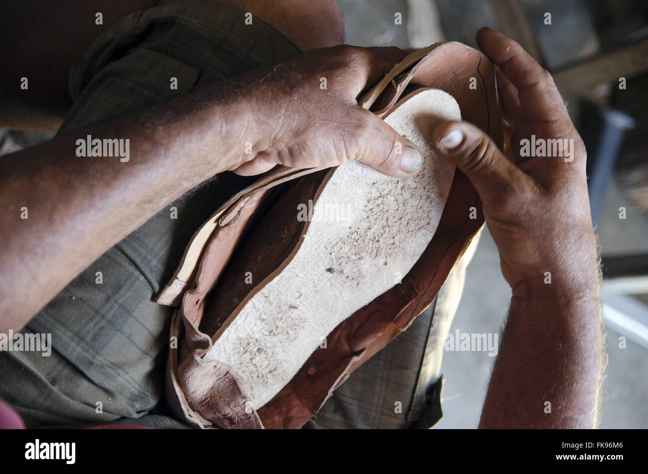 Leather craftsman producing shoes manually workshop in Pernambuco backlands - Stock Image