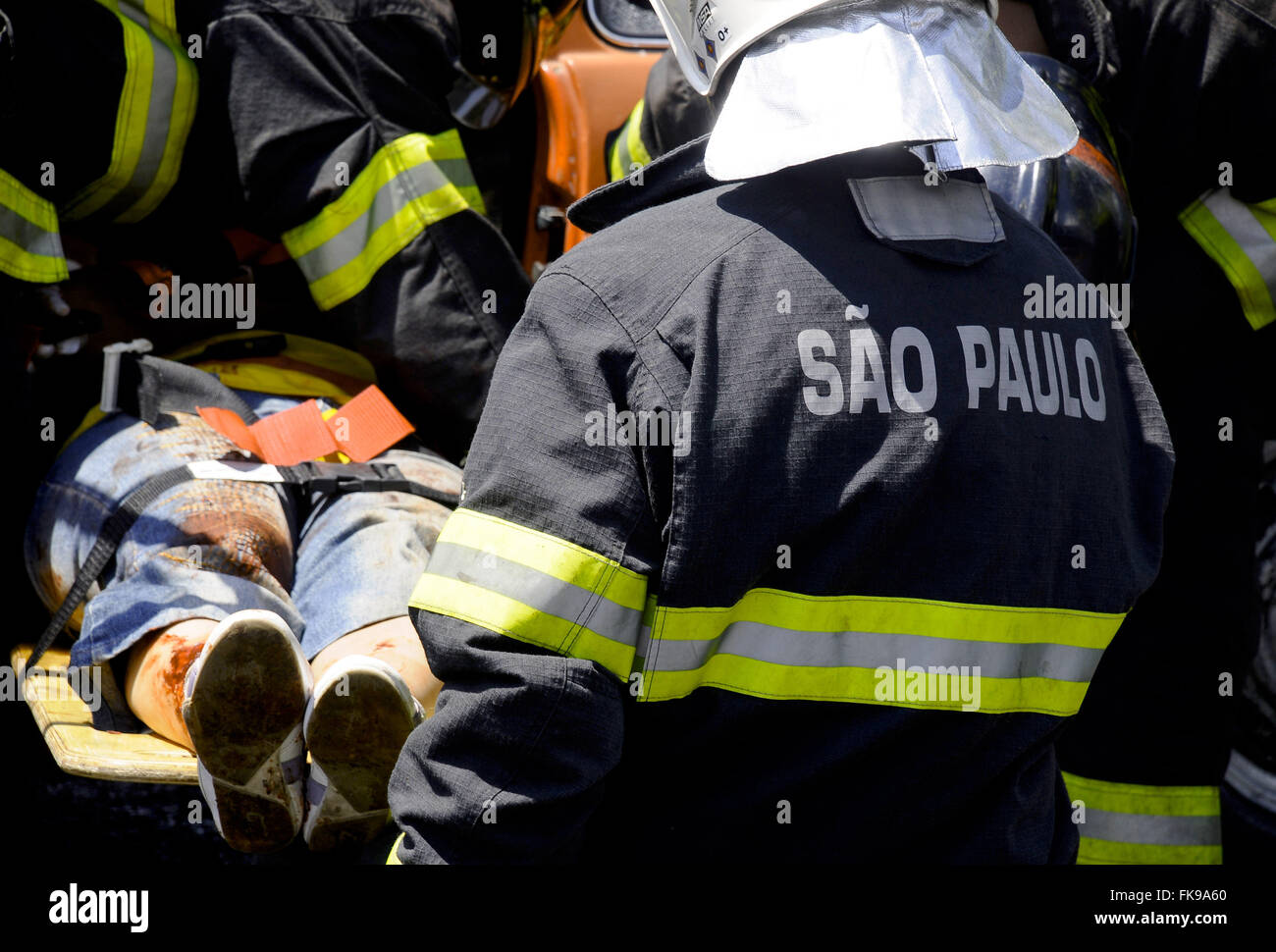 Workers injured person aiding in traffic in the capital - Stock Image