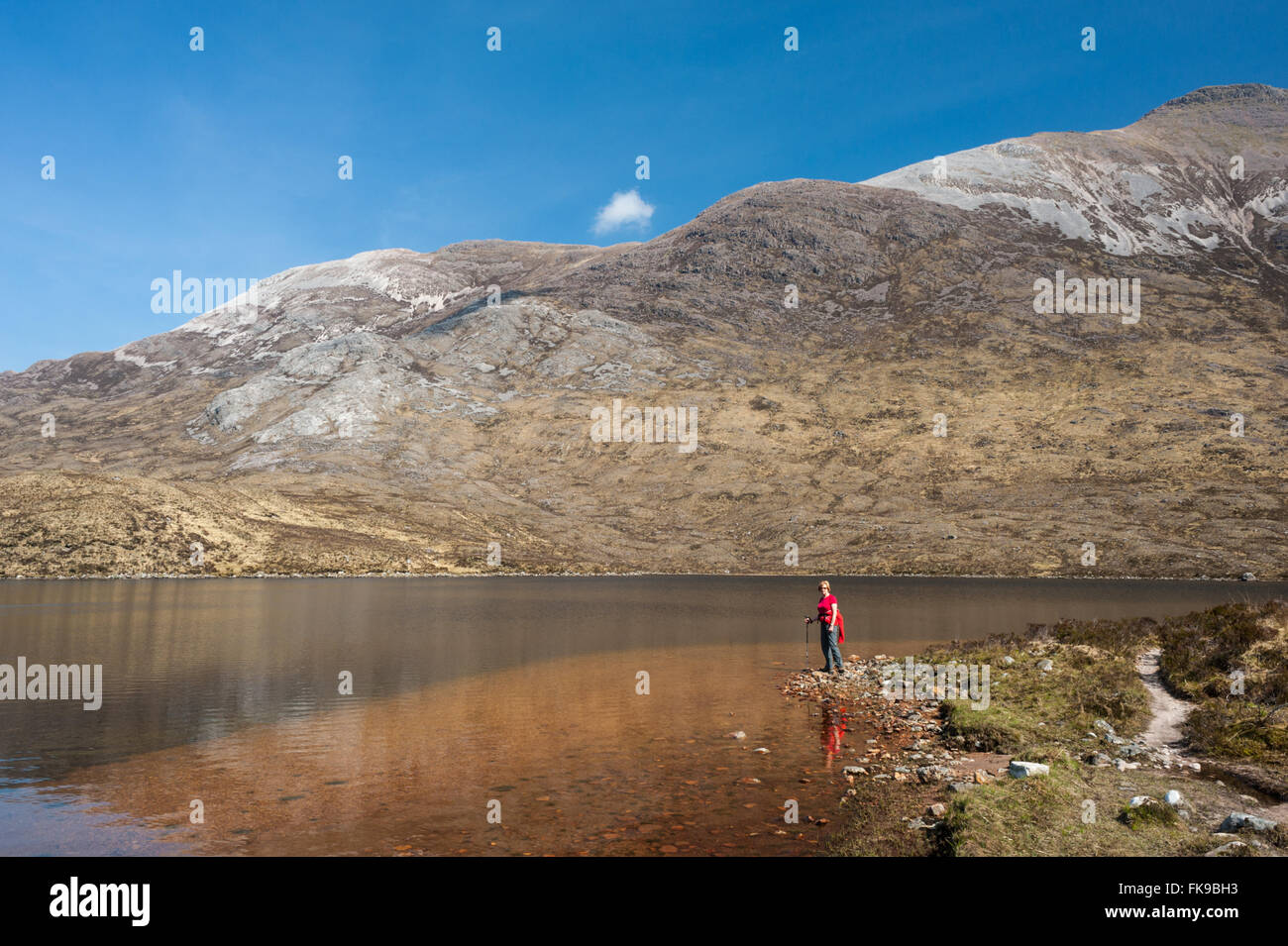 Loch Coire Fionnaraich and the slope of Sgorr Ruadh - Stock Image