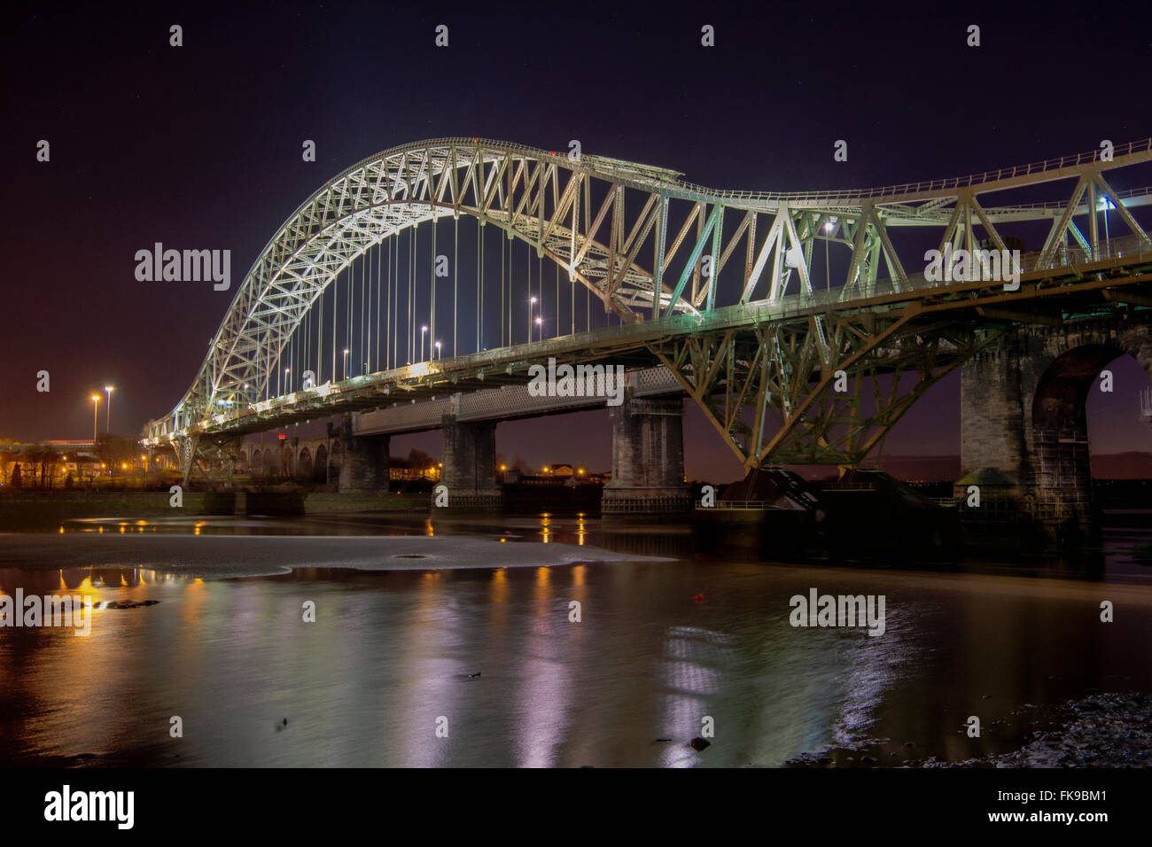 The Jubilee Bridge connecting Runcorn and Widnes across the River Mersey. - Stock Image