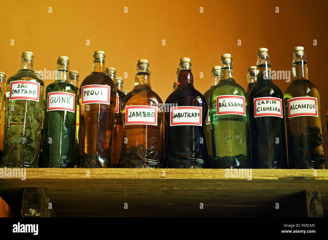 Store shelf with bottles of rum tanned using herbs typical of the cerrado - Stock Image