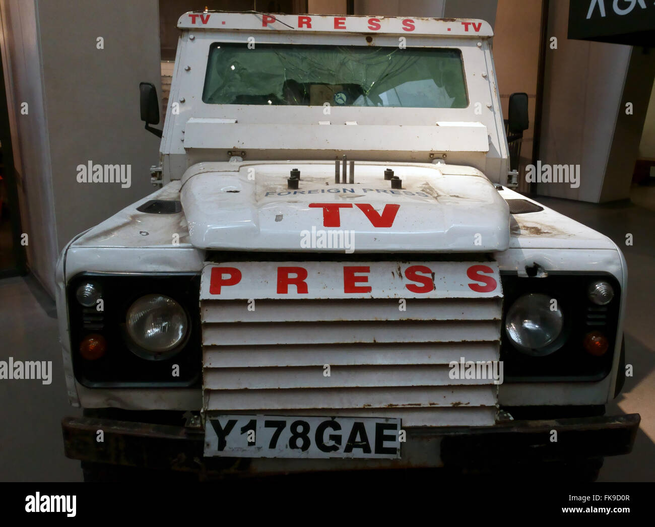 A landrover used by news crews in war zones make a stark display in the Imperial War Museum foyer London UK - Stock Image