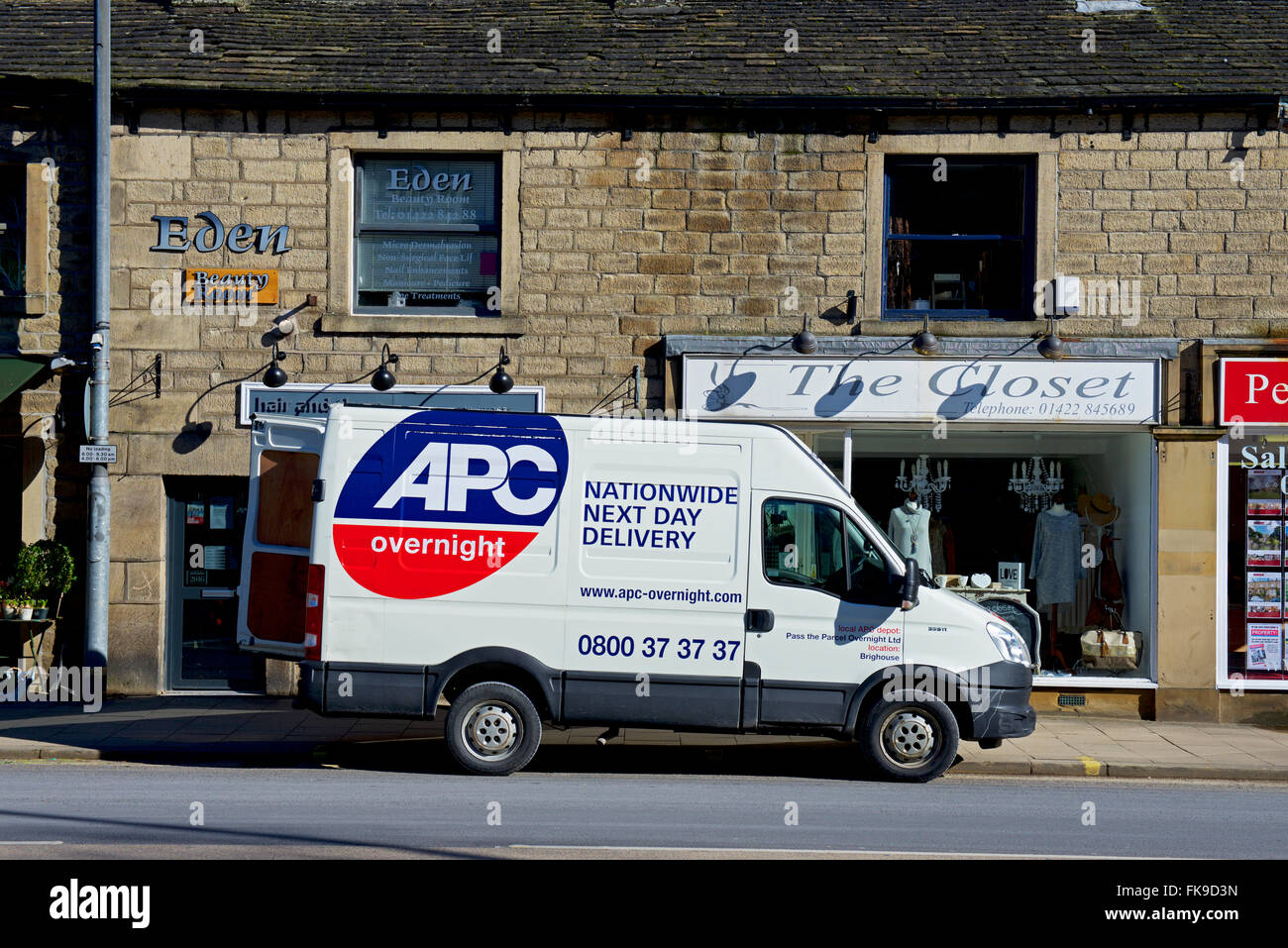 APC Nationwide delvery van parked outside shops, England UK - Stock Image