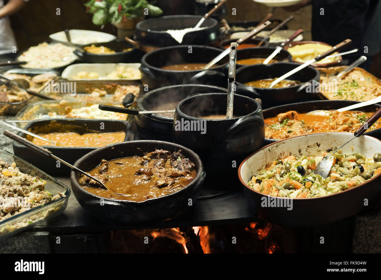 Wood stove with typical local food. Stock Photo