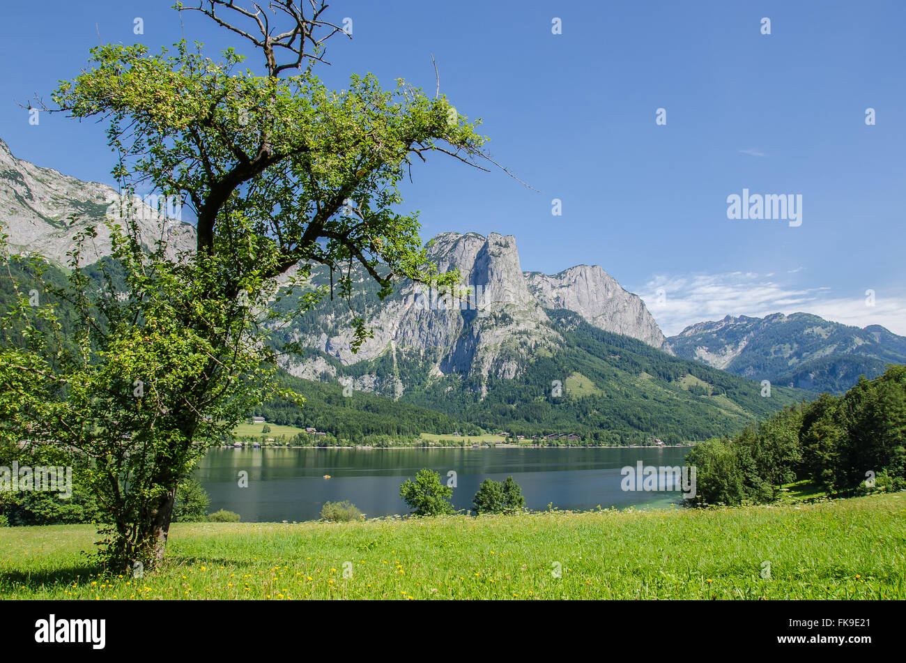 The Grundlsee vacation region is one big natural playground: the Grundlsee invites you to swim and relax. Stock Photo