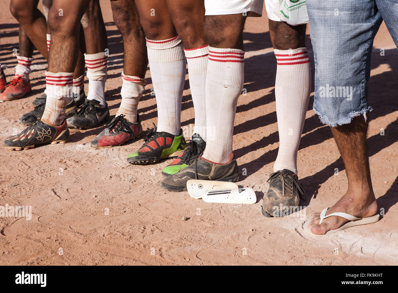 Detail of cleats soccer players of floodplain - Stock Image