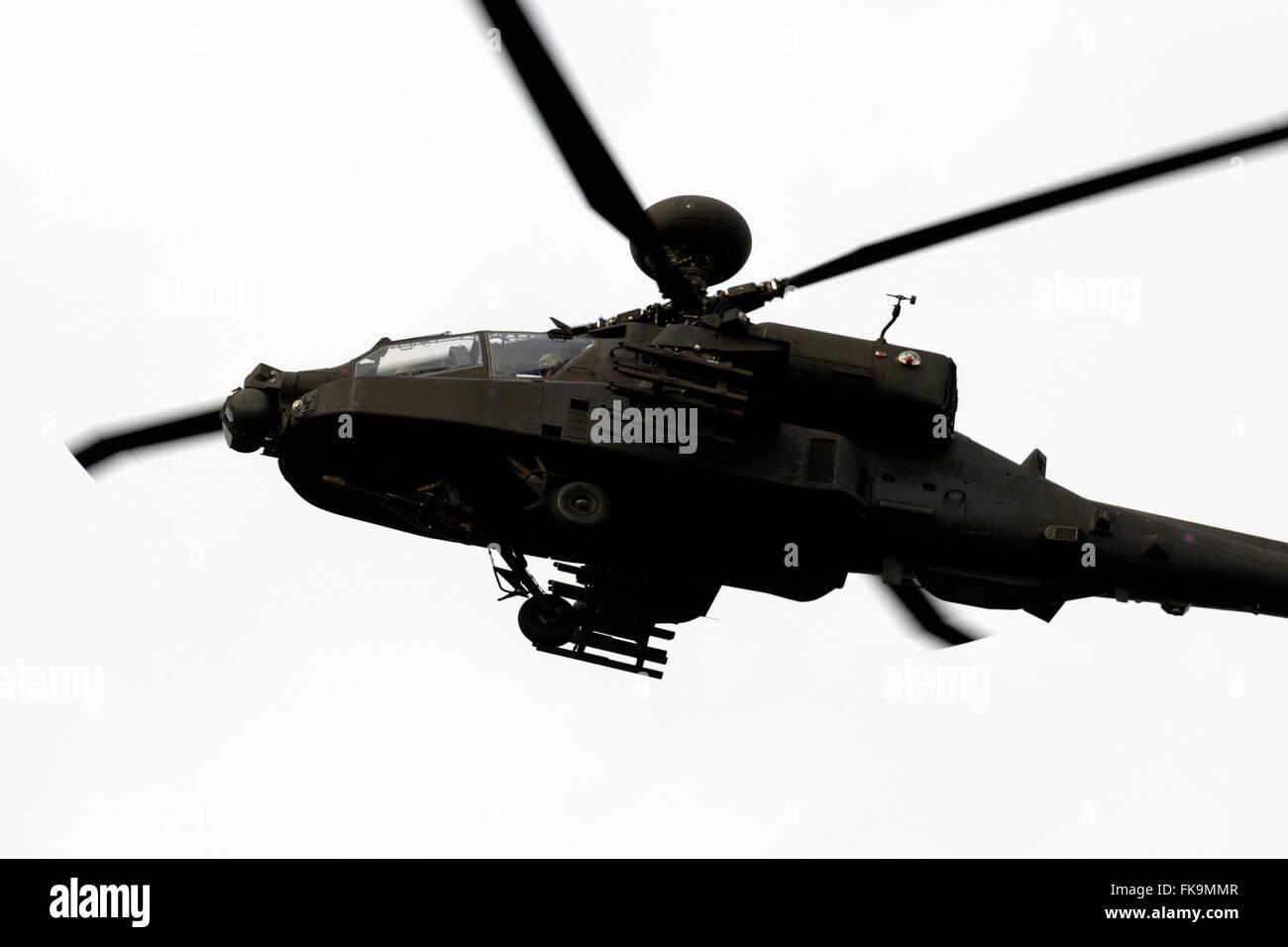 AgustaWestland Apache attack helicopter from RAF Wattisham over Rendlesham forest Suffolk UK - Stock Image