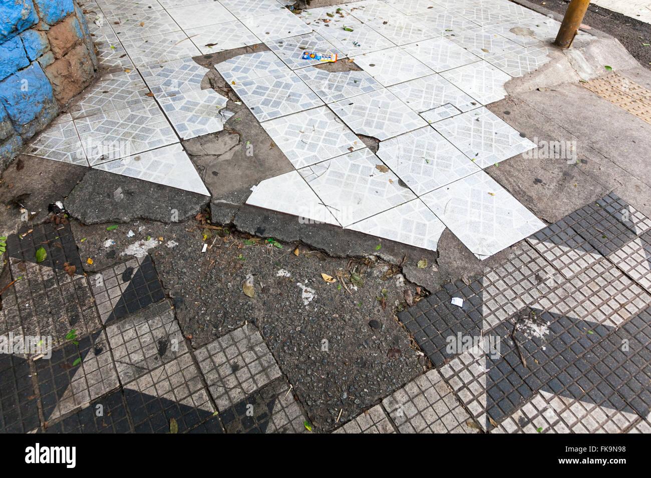 Run down pavements in Sao Paulo, Brazil - Stock Image
