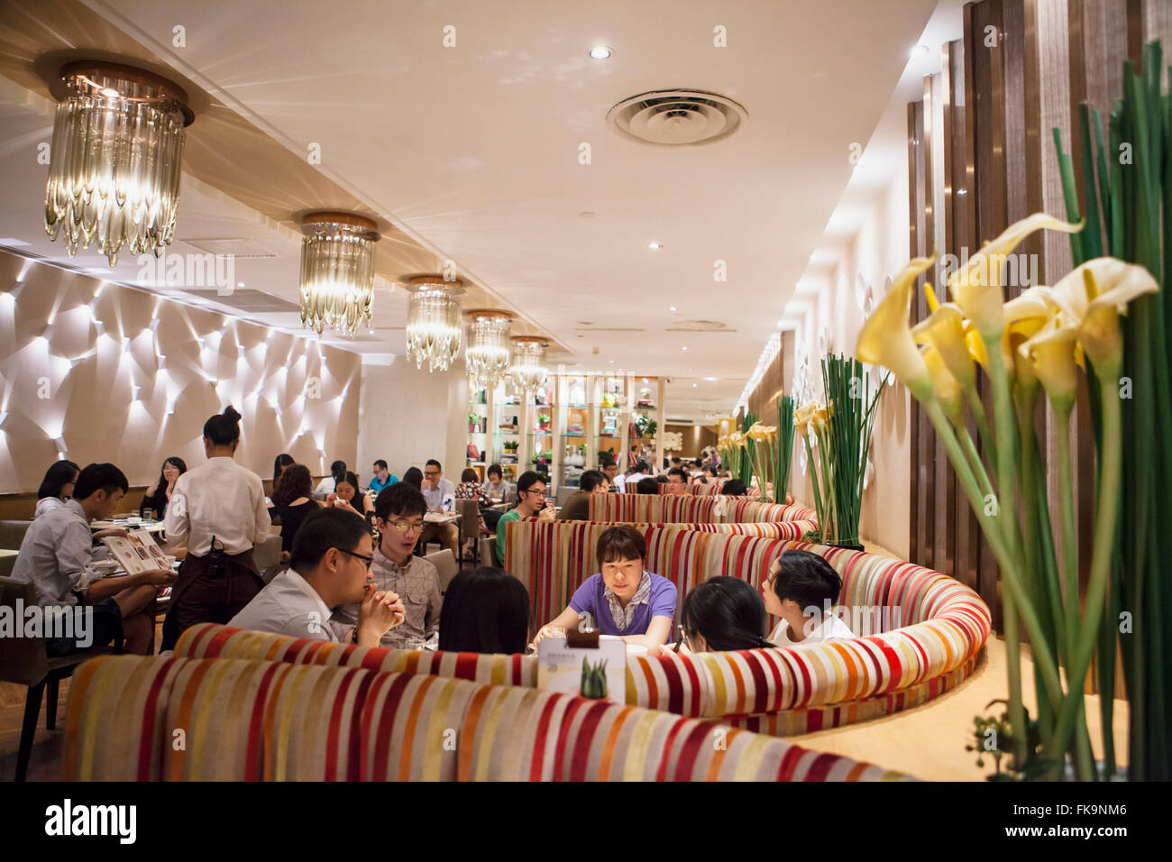 shoppers dine at a restaurant in the Tee Mall, Guangzhou, China - Stock Image