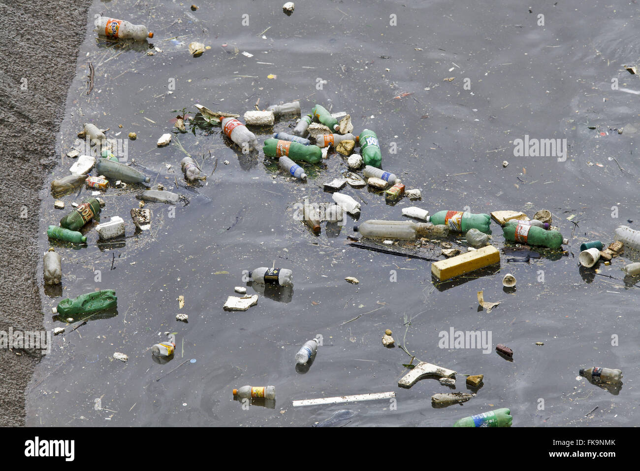 Trash floating on the river in flood season Tiête - Stock Image
