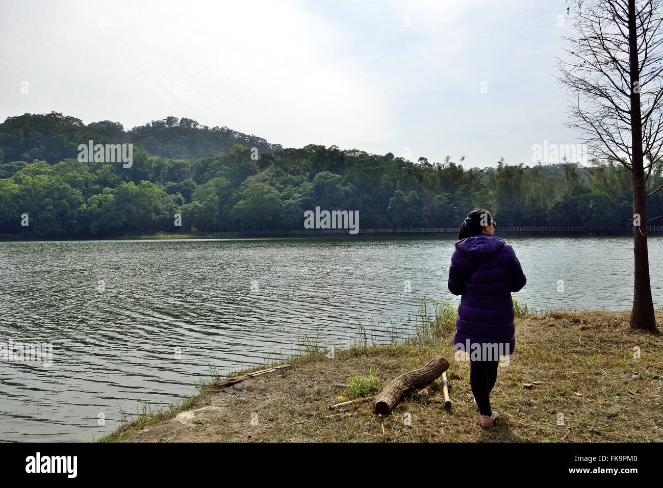 a woman stand near the lake Stock Photo