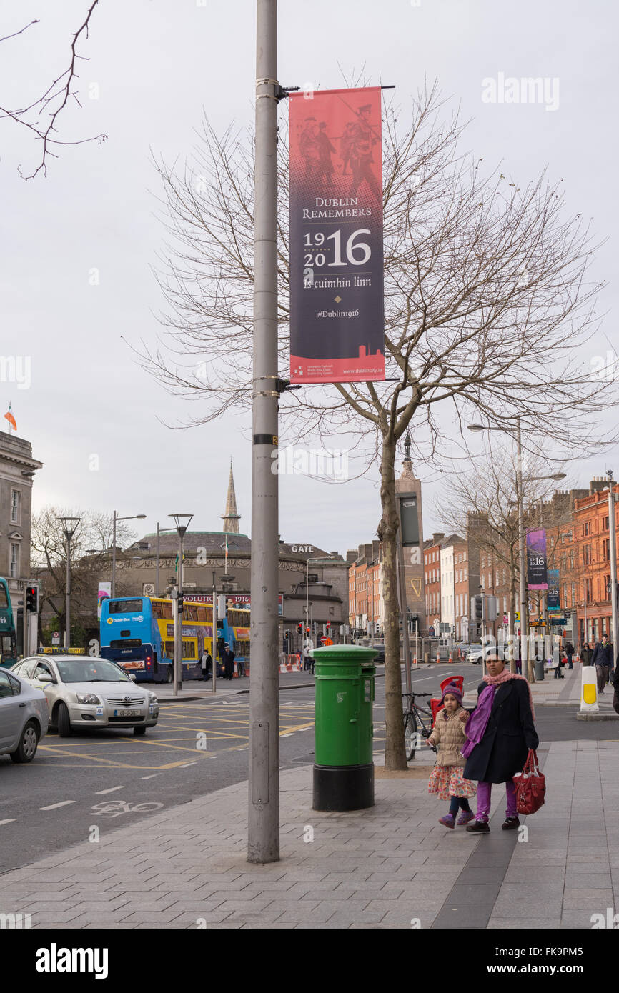 Dublin Remembers 1916 banners and flags commemorating the Rising on flagpoles and lampposts sround the city centre - Stock Image