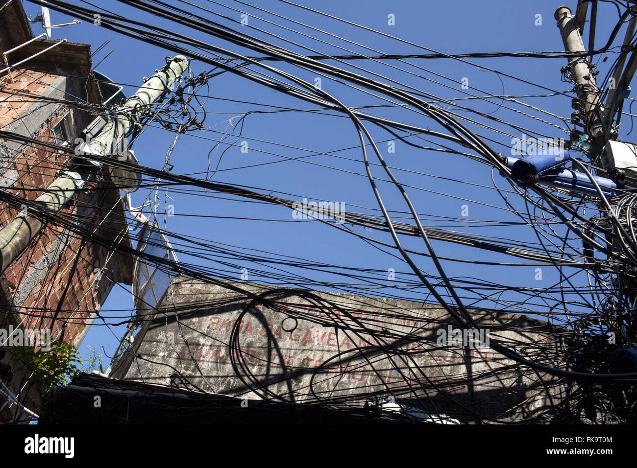 Underground wiring cat calls in the Favela Rocinha Stock ... on underground generator, underground transmission, underground wire in shorts,