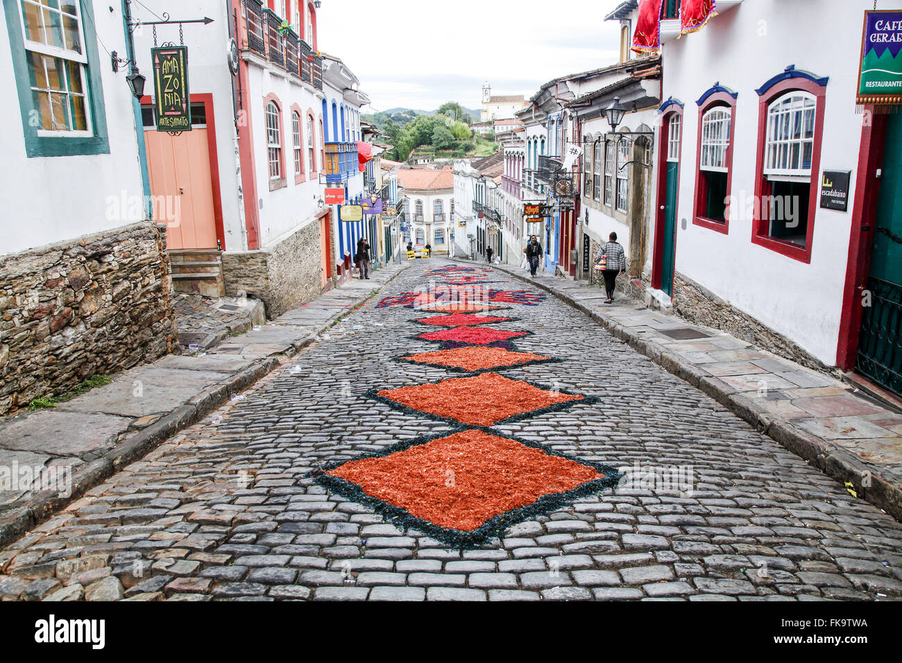 Street decorated with carpets of colored sawdust for the procession of Corpus Christi - Stock Image