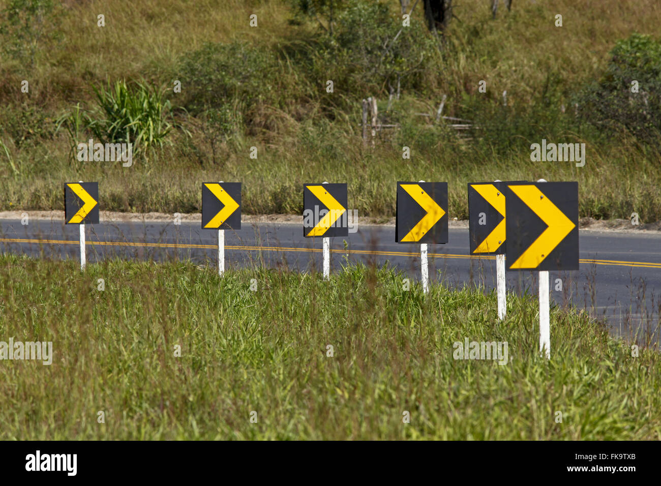 Signaling curve in the road carriageway - Stock Image