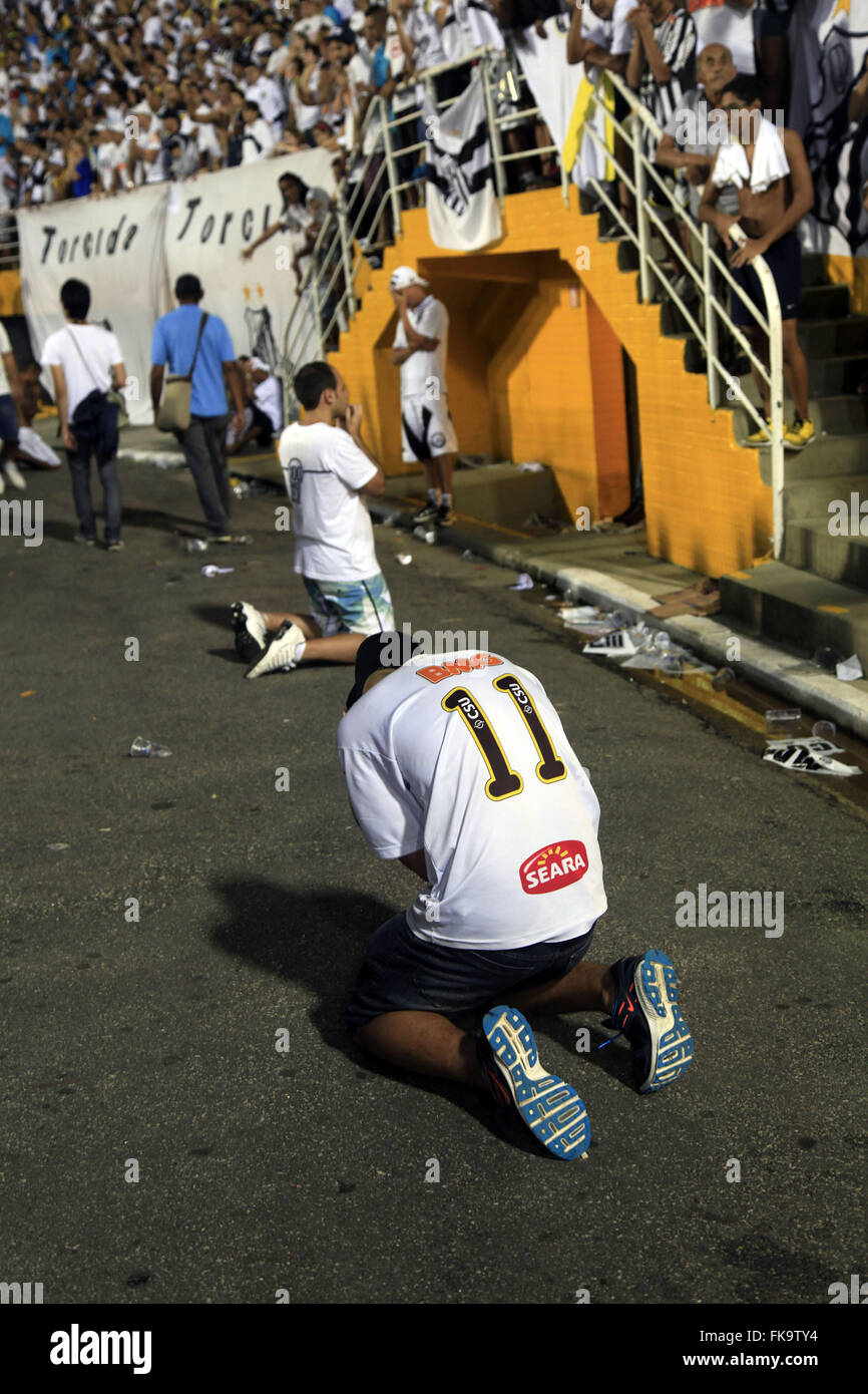 Supporter praying for his team in the second game of the finals of the Championship between Santos and Ituano - Stock Image