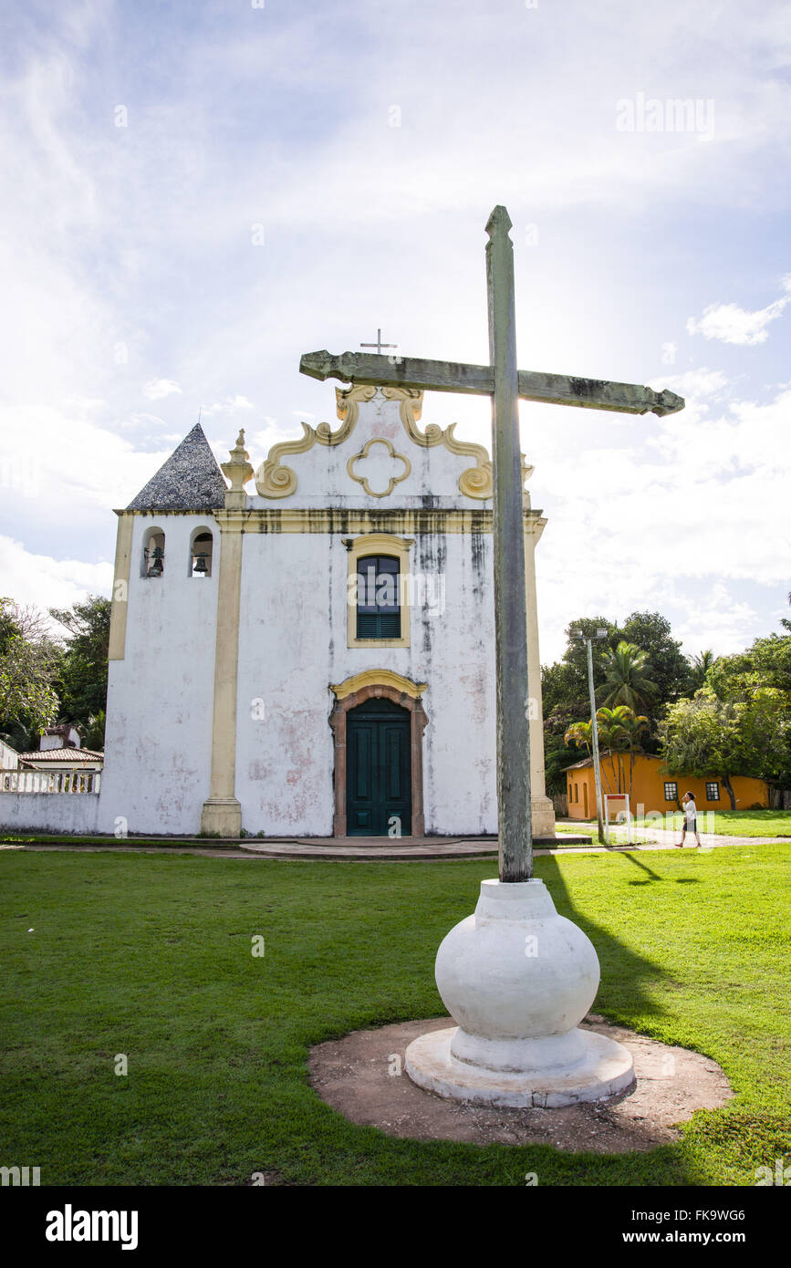 Cross in front of the Parish Church Our Lady of Sorrow, 1535 in historic downtown - Stock Image