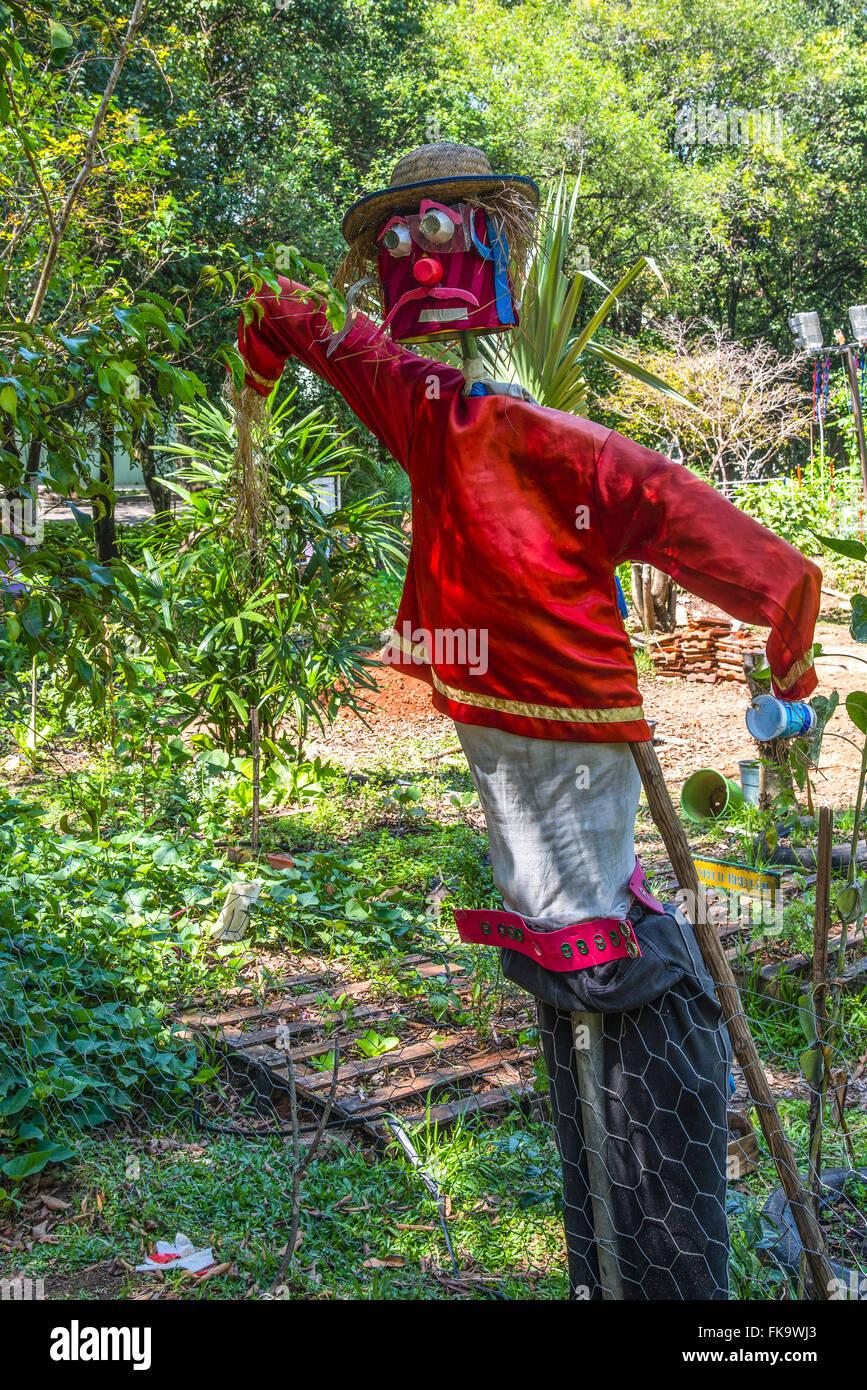Scarecrow in the community garden Praca of Owls - Stock Image