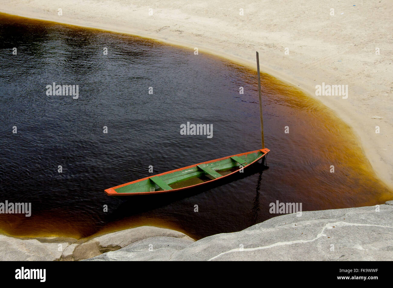 Wooden canoe moored in the cove on the banks of the Rio Negro - Stock Image