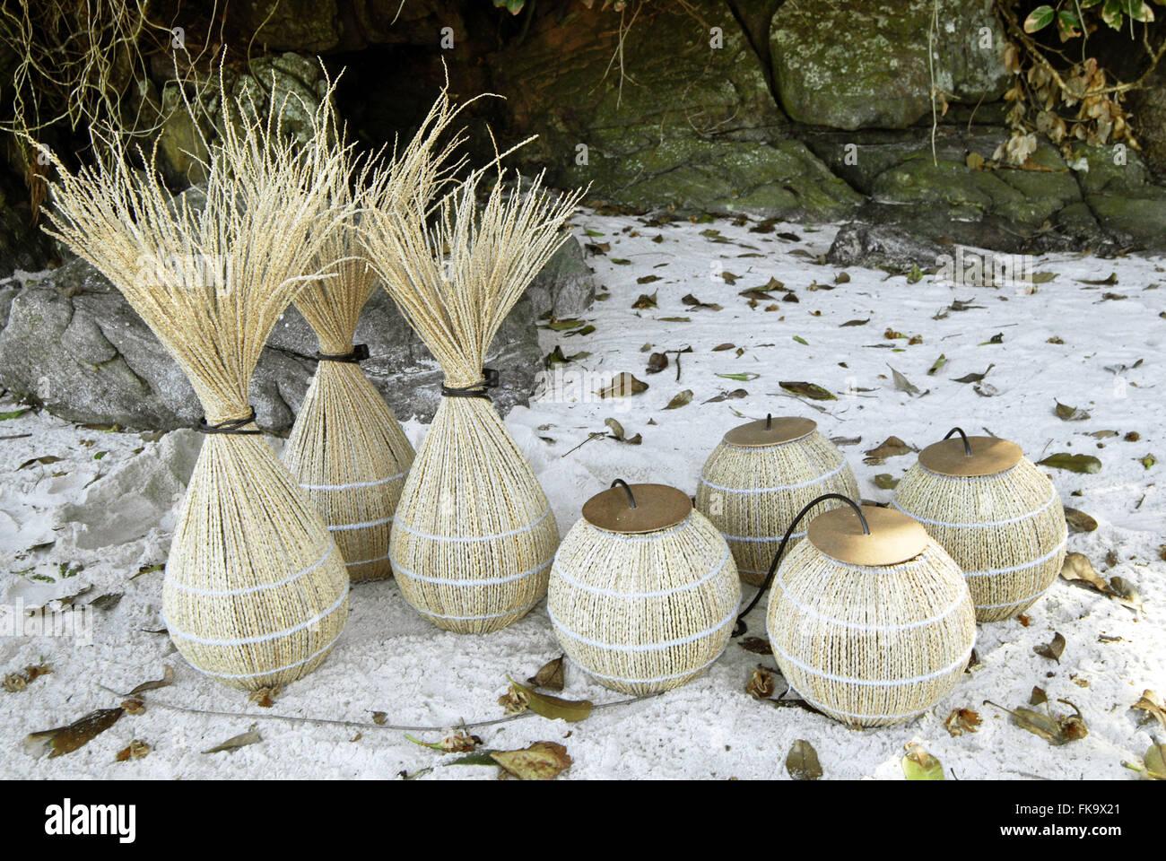 Crafts acai palm thatch exposed on Maresias Beach - Stock Image