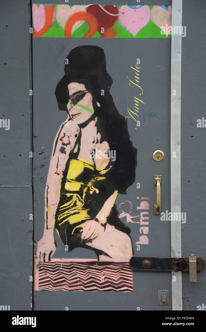 Amy Winehouse, English singer songwriter. Stencilled graffiti art on a door in Camden Town. Painted by Bambi. London, - Stock Image