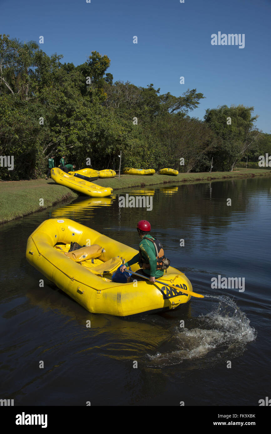 Preparation of inflatable boats for tourists training in lake - Stock Image