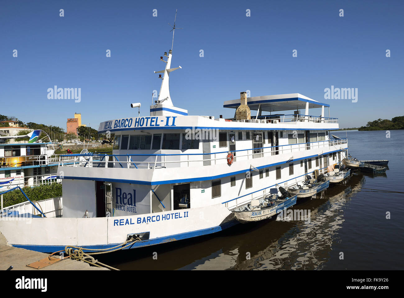 Central motor boat that works as a means of transport and tourism for fishermen - Stock Image
