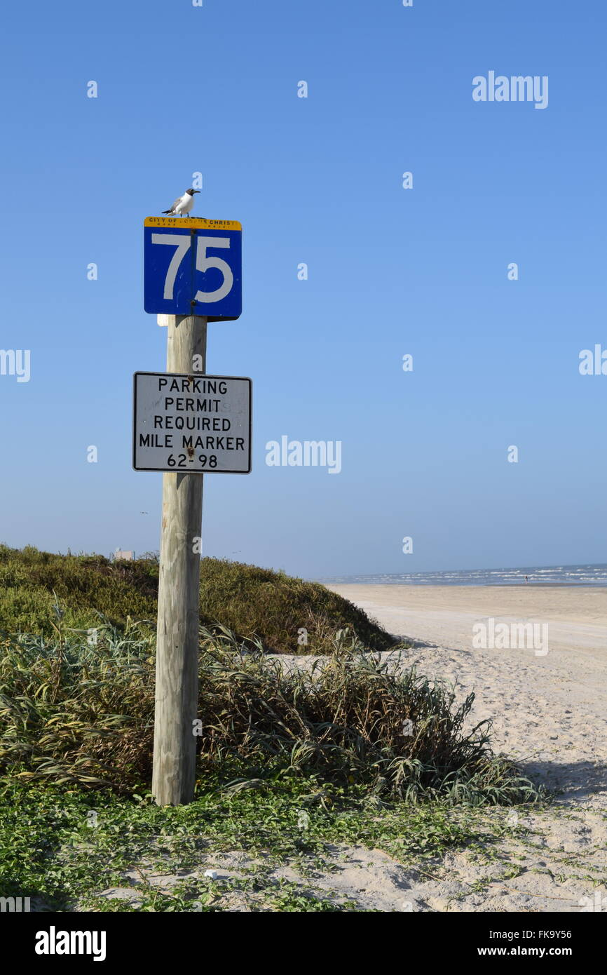 Mile marker on Mustang Island, Texas. - Stock Image