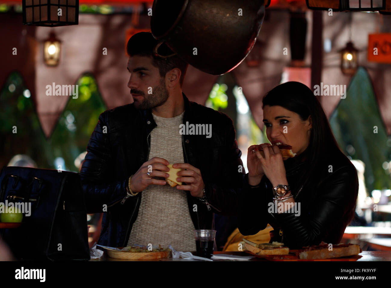 Woman and man eating ham and cheese - Stock Image