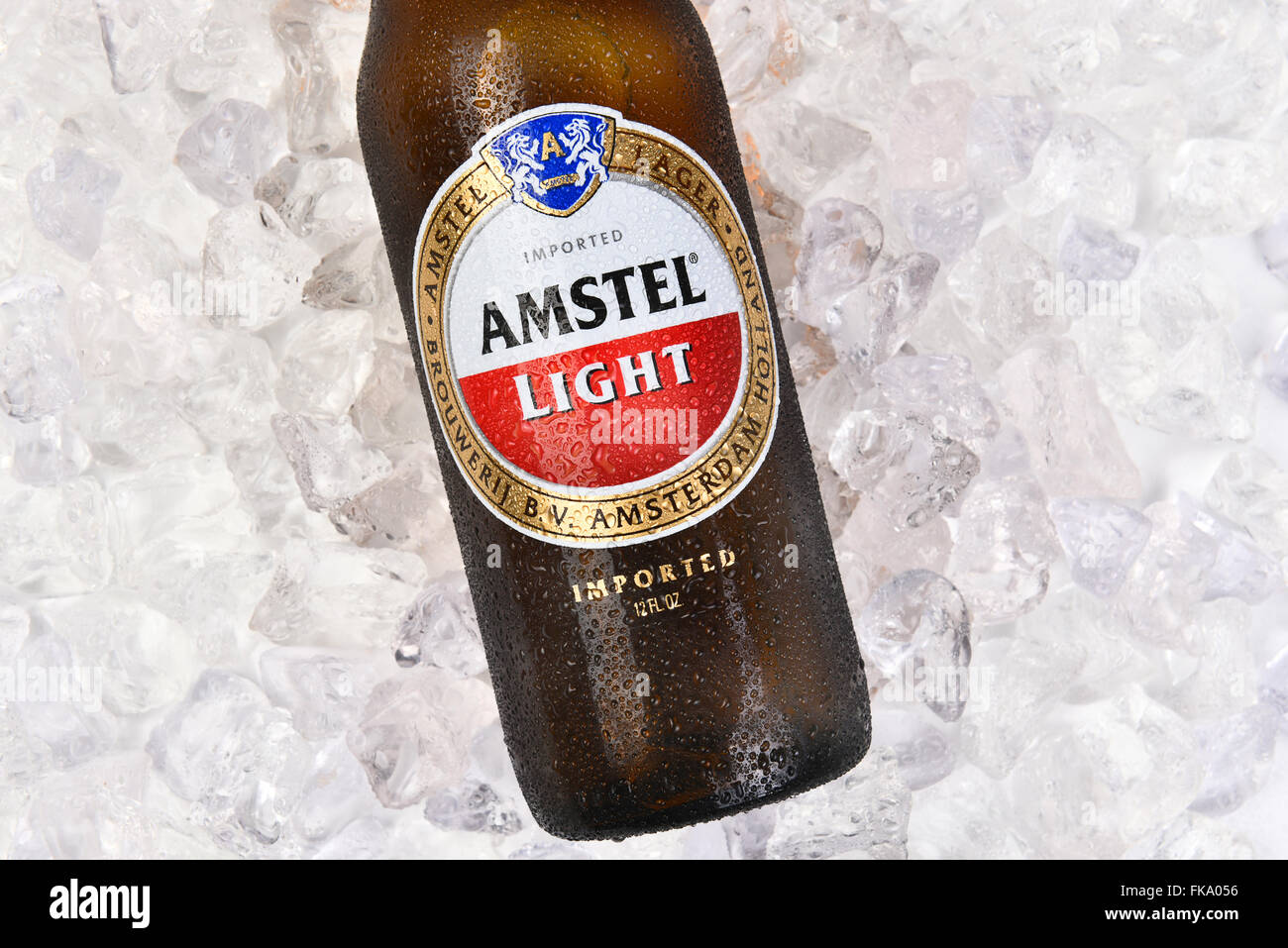 Amstel Light Bottle On A Bed Of Ice. Horizontal Format Closeup Of Label.