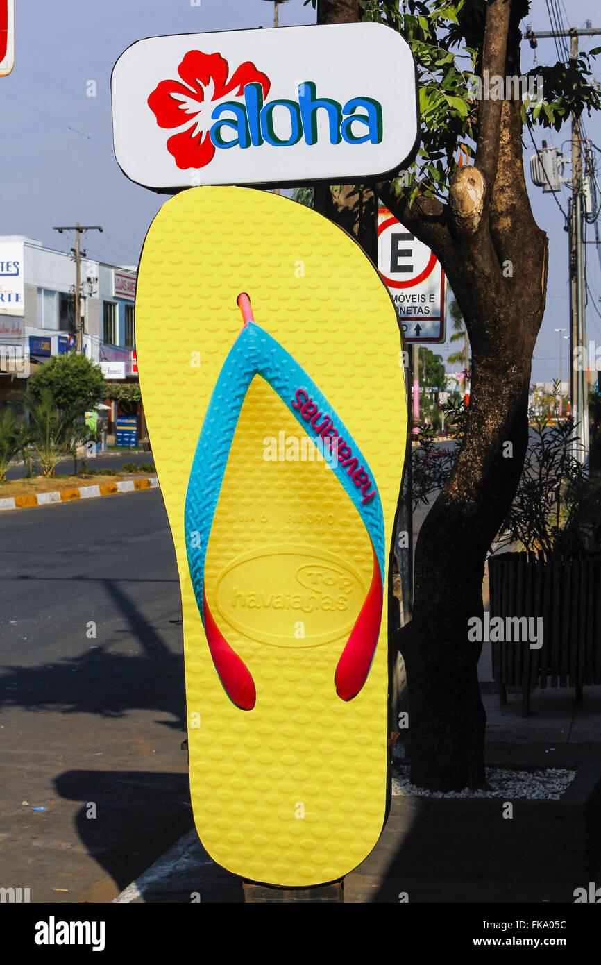 Giant Slipper for advertising on sidewalk - Stock Image