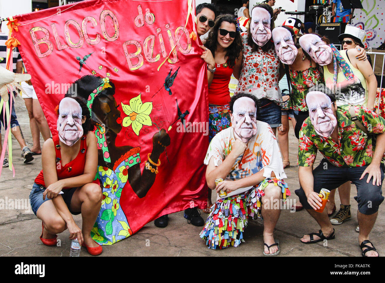 Revelers pack Kiss with masks in the carnival of marches - historic center - Stock Image