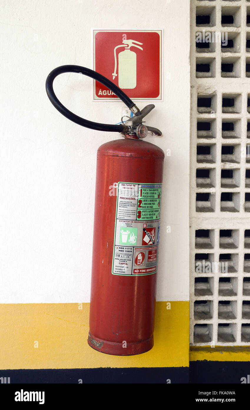 Fire extinguisher pressurized water base in residential building - Stock Image