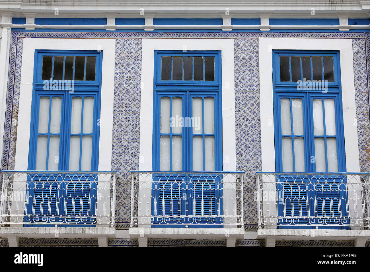 Detail of the facade of colonial townhouse decorated with Portuguese tiles - Stock Image