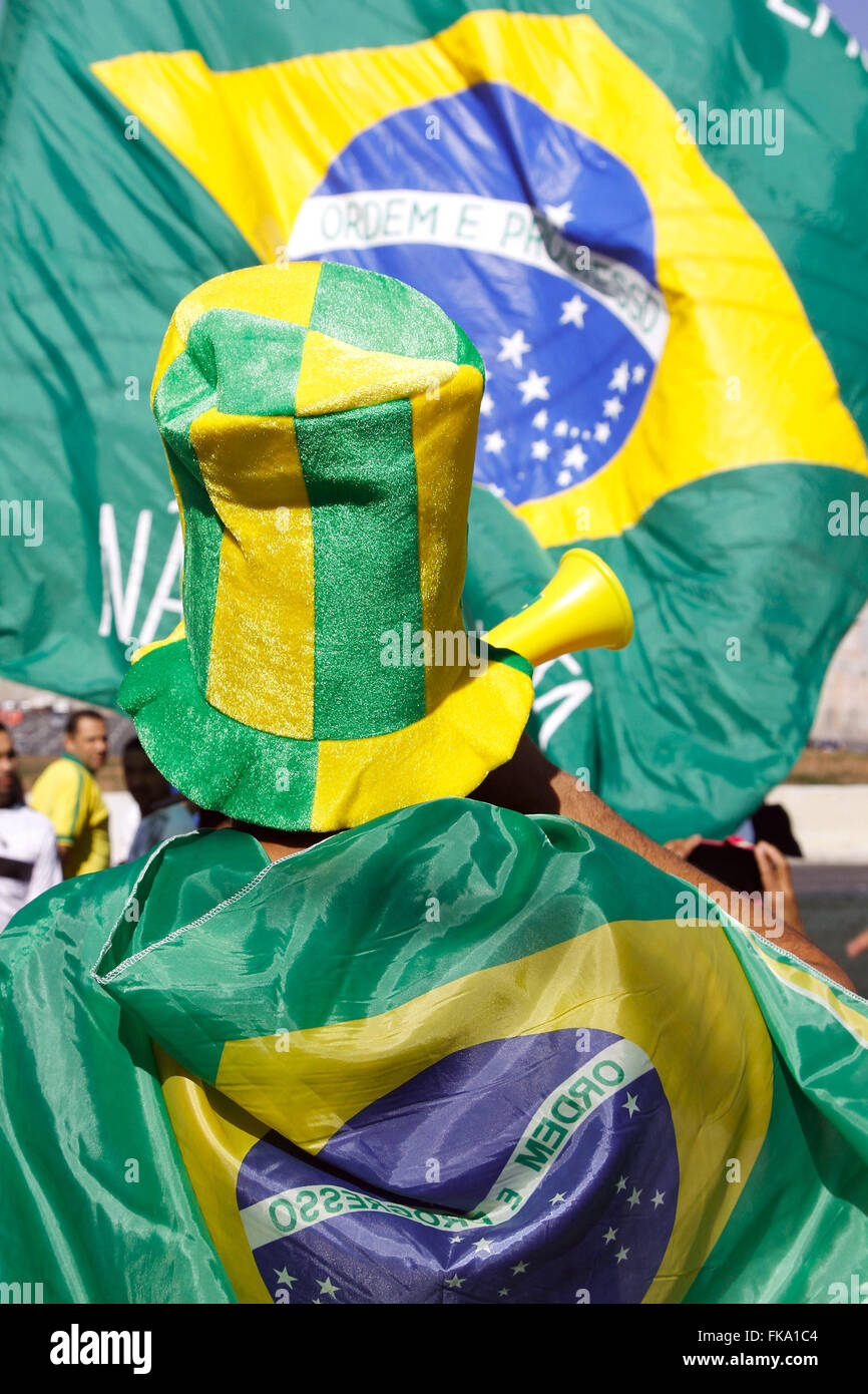 Supporter of Brazil celebrates on the Corinthians Arena at the opening of the World Cup - Stock Image