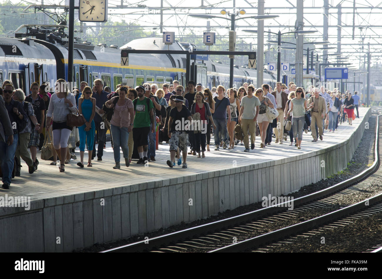 Passengers on the Central railway platform - Centraal Station - Stock Image